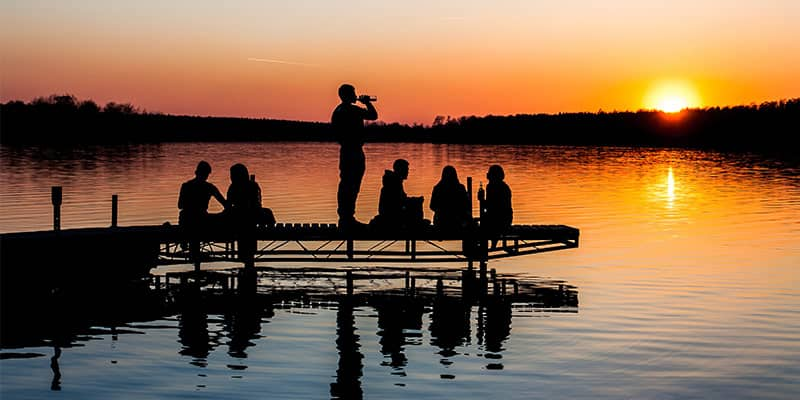 People on dock at lake